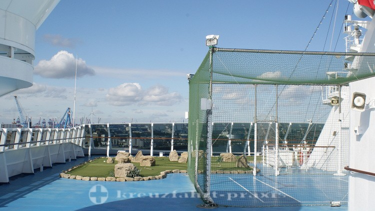Paddle tennis cage and mini golf