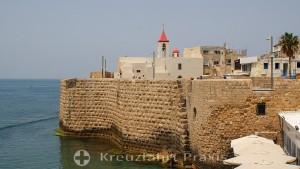 Akko - fortress wall at the harbor with St. John's Church