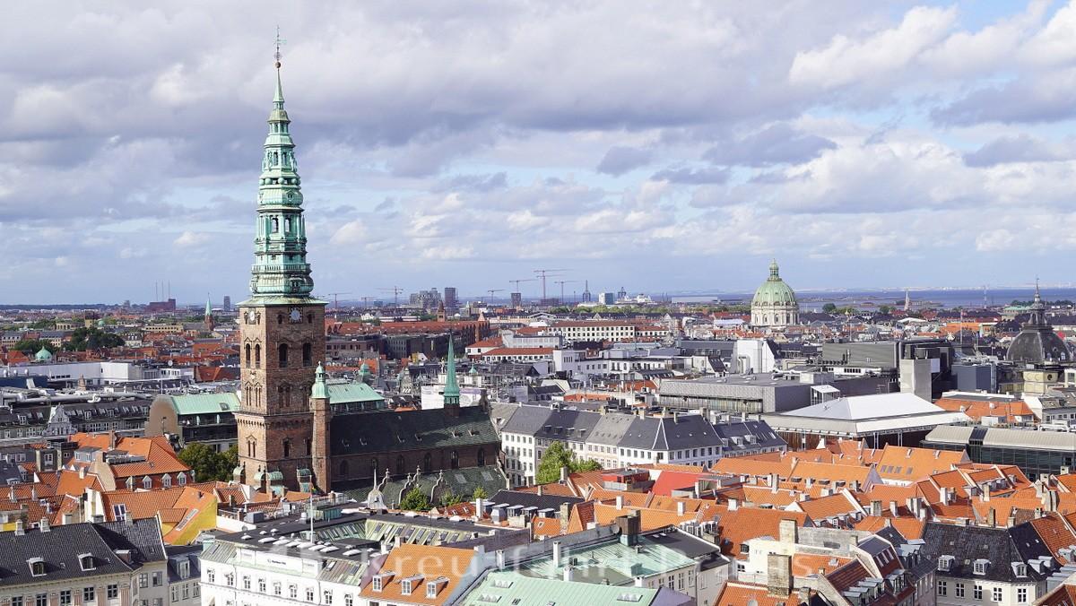 Copenhagen's sea of houses with the tower of the Nikolaj-Kunsthalle