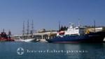 Schiffe vor der Muelle Uno
