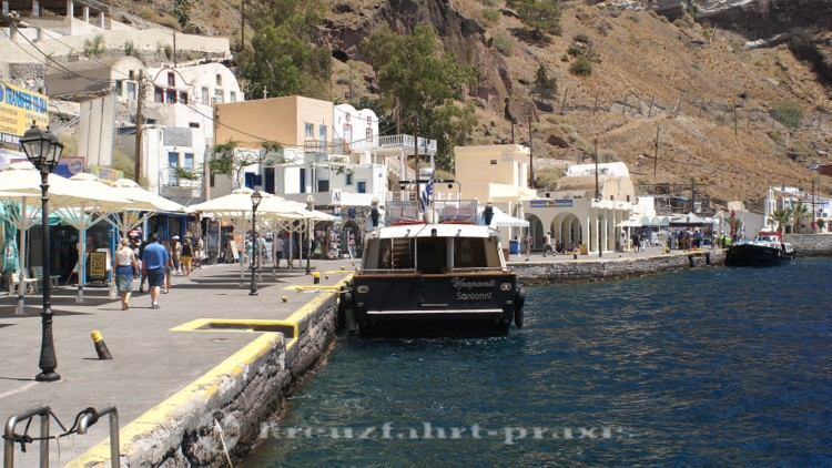 Santorini - tender boat in the port of Skala / Fira